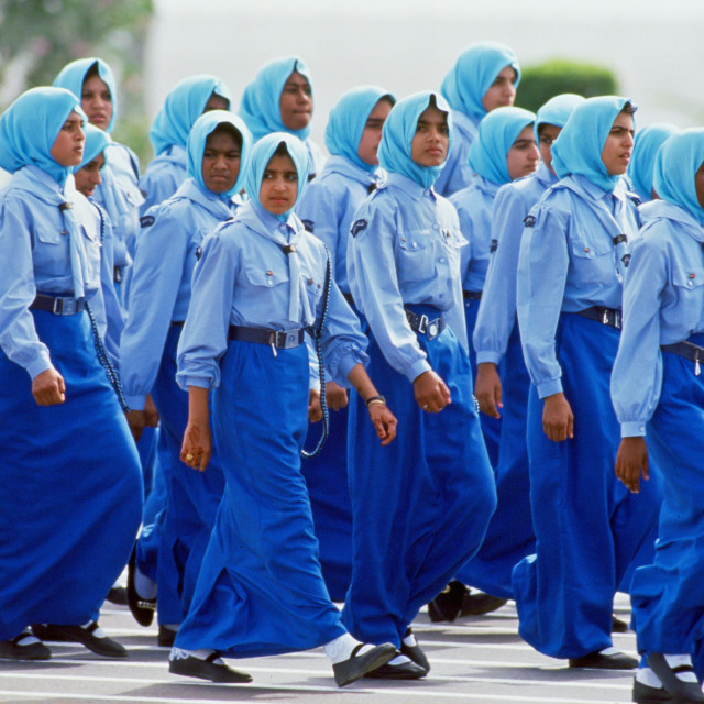 """Young arab women take part in an anniversary parade, Abu Dhabi"" stock image"