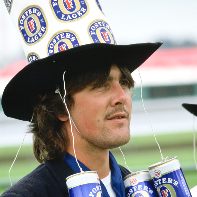 """""""Racegoer wearing a ' Fosters Lager' hat to the Melbourne Cup Race Day,..."""" stock image"""