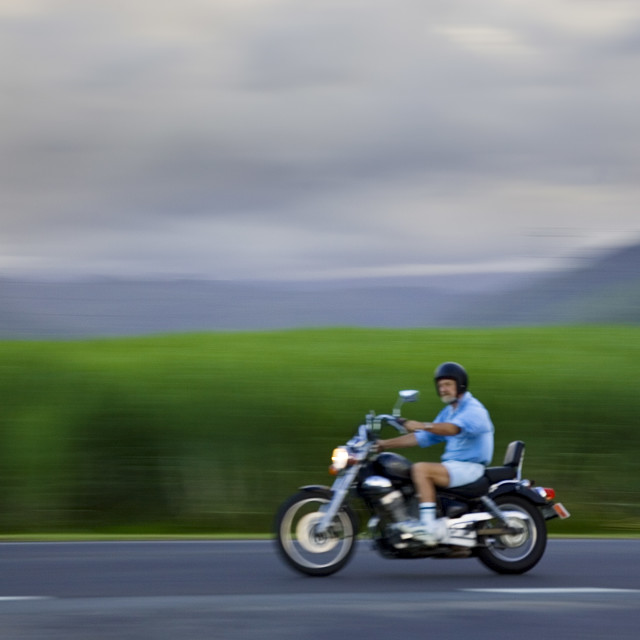 """""""Motorcyclist passes sugar cane field at Freshwater Connection, Australia"""" stock image"""