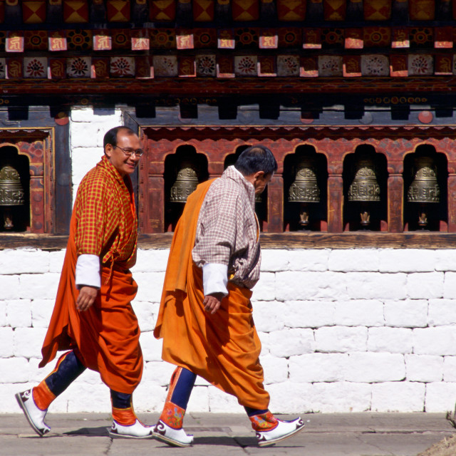 """Two men wearing traditional clothing in Paro, Bhutan"" stock image"