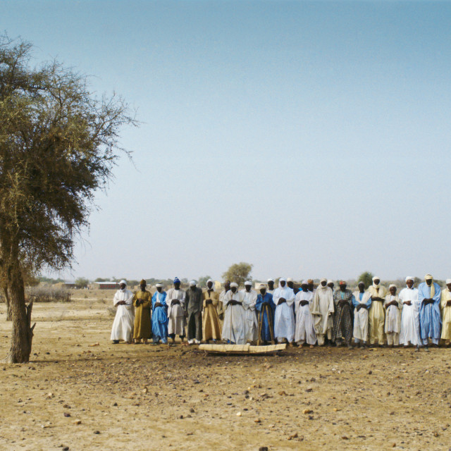 """Muslims pray to the east during a funeral in the desert, Burkina Faso,..."" stock image"