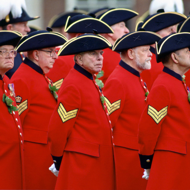 """""""Chelsea Pensioners, wearing their traditional uniform of red coat and black..."""" stock image"""