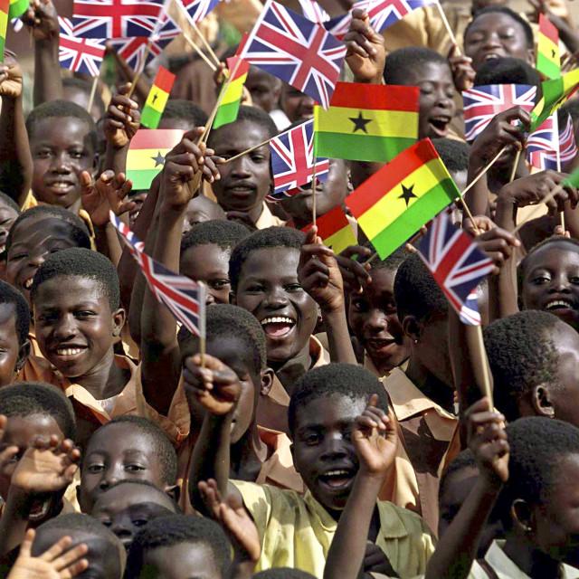 """Children in Accra waving British and Ghana flags"" stock image"