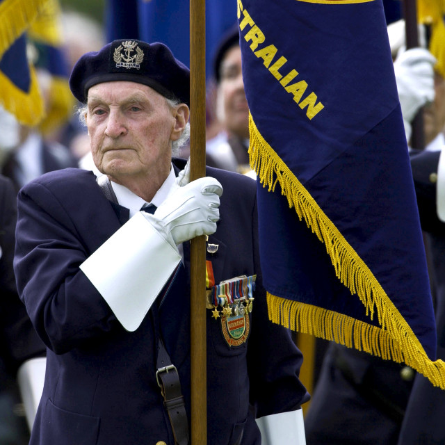 """""""Veterans of the D-Day Landings with their flags in a parade at the start of..."""" stock image"""