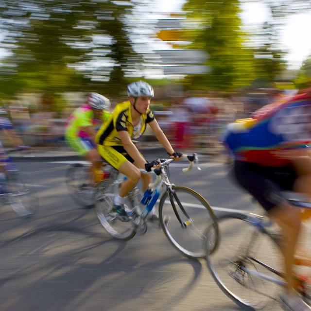 """""""Cyclists take part in Le Prix De La Ville De Lucmau in France"""" stock image"""