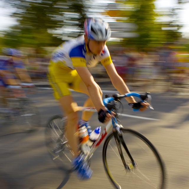 """""""Cyclist takes part in Le Prix De La Ville De Lucmau in France"""" stock image"""