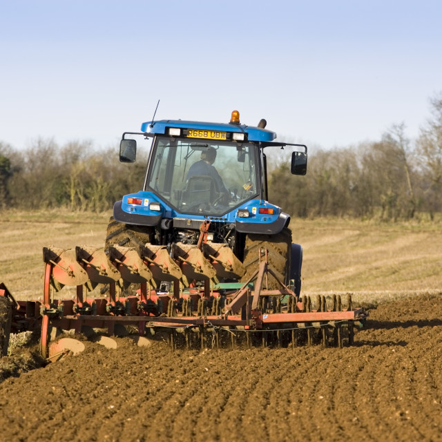 """""""Tractor ploughing field in Oxfordshire, The Cotswolds, United Kingdom"""" stock image"""