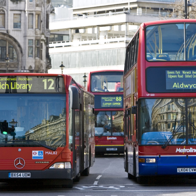 """Public transport buses travel in heavy traffic in Trafalgar Square, London..."" stock image"
