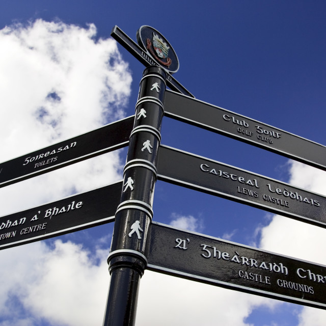 """Bilingual road sign English and Scottish Gaelic directions, Stornoway, Outer..."" stock image"