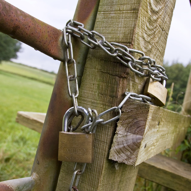 """""""Gate locked with padlocks and a chain, Oxfordshire, United Kingdom"""" stock image"""
