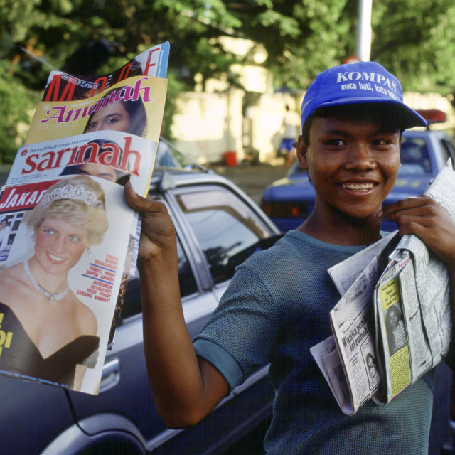 """Boy sells magazines, in Jakarta, that have Diana, Princess of Wales on the..."" stock image"