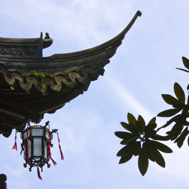 """""""Chinese lantern hanging from traditional style roof, in the Yu Gardens,..."""" stock image"""