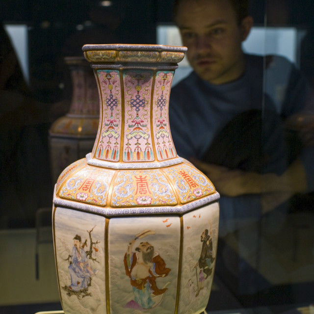 """Visitor looks at Ming vase on display in the Shanghai Museum, China"" stock image"