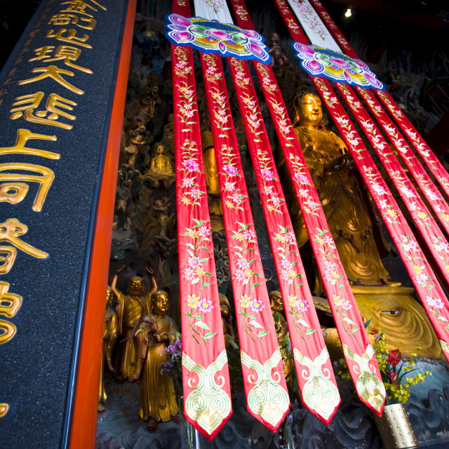 """""""Golden Buddha and silk banners in the Grand Hall of Magnificence of the Jade..."""" stock image"""