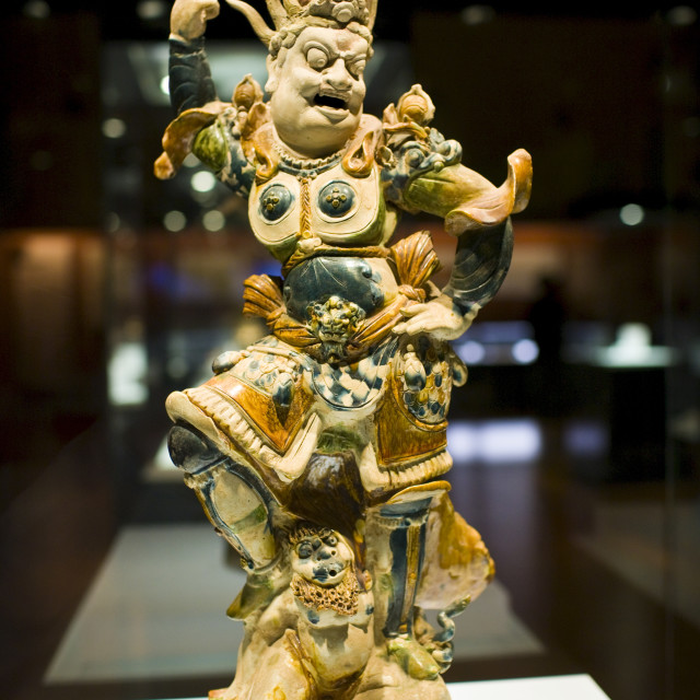 """Figurine on display in glass case in the Shaanxi History Museum, Xian, China"" stock image"