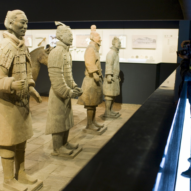 """Tourist photographs Terracotta warriors on display in the Shaanxi History..."" stock image"