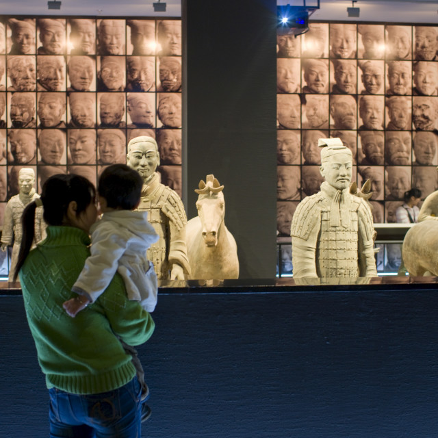 """Tourists view Terracotta warriors on display in the Shaanxi History Museum,..."" stock image"