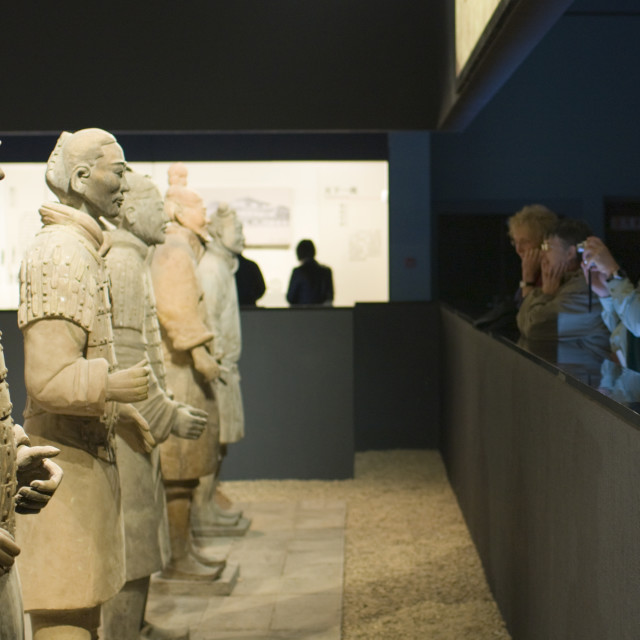 """Tourists photograph Terracotta warriors on display in the Shaanxi History..."" stock image"