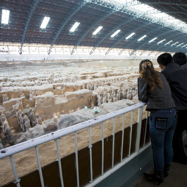 """Tourists view infantry figures from the edge of Pit 1 at Qin Museum,..."" stock image"