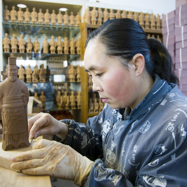 """""""Woman makes Terracotta Warrior souvenirs in factory, Xian, China"""" stock image"""