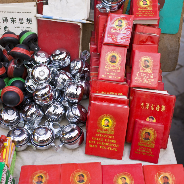 """Chairman Mao's Little Red Book and bicycle bells for sale on market stall in..."" stock image"