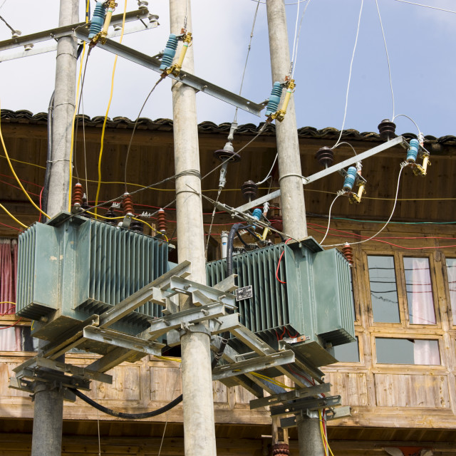 """""""Telegraph pole with telephone and power lines installed in the mountain..."""" stock image"""