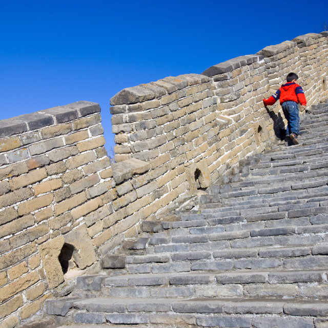 """Chinese boy walking up steps of the Great Wall of China at Mutianyu, north of..."" stock image"