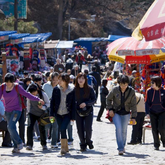 """Tourists walk through souvenir stalls at The Great Wall of China, Mutianyu,..."" stock image"
