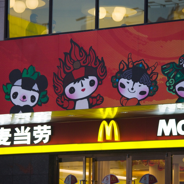 """Olympics official Fuwa mascot characters on McDonalds fastfood restaurant,..."" stock image"