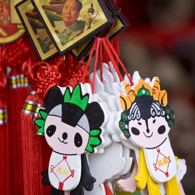 """""""Souvenirs including Chairman Mao Keyrings and unofficial 2008 Olympic mascots..."""" stock image"""