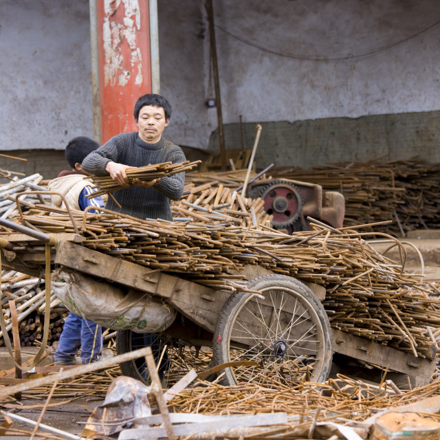 """Man and boy working at metal recycling steel, loading a wooden cart, in Dazu..."" stock image"