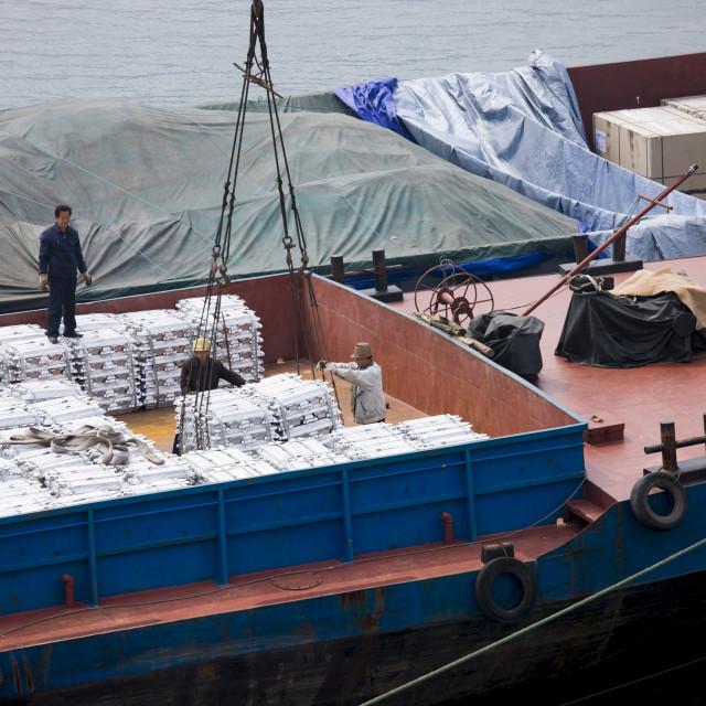 """Aluminim ingot blocks being loaded onto cargo ship, Yichang, China"" stock image"