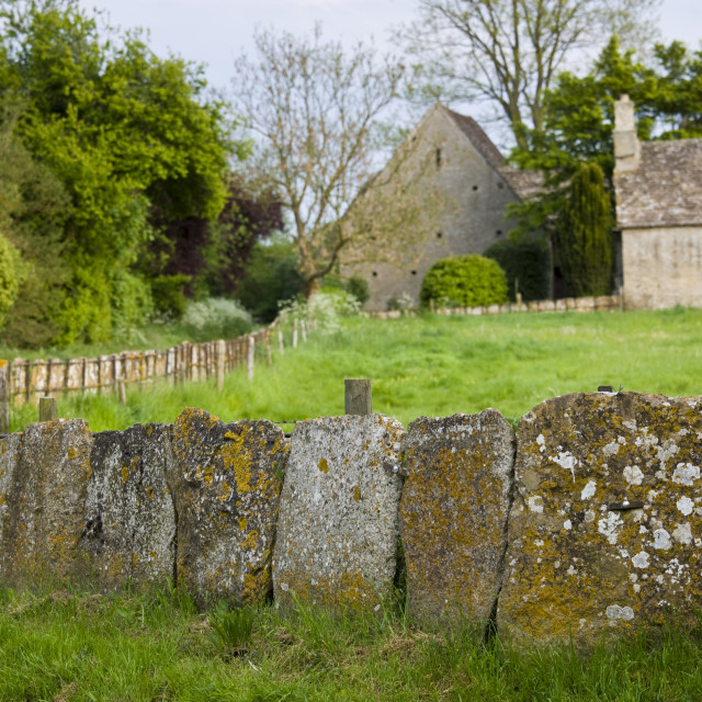"""Cotswolds village, country lane and old stone slab fencing in Kelmscott, The..."" stock image"