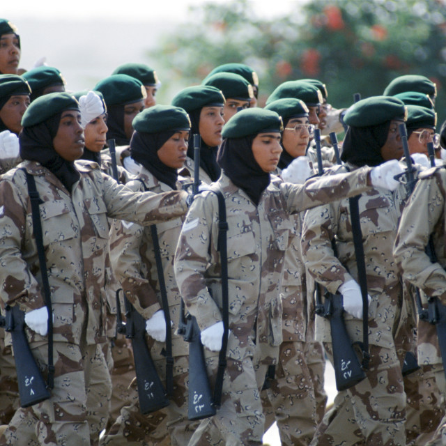 """Female armed soldiers parade in camouflage uniform in Abu Dhabi for..."" stock image"