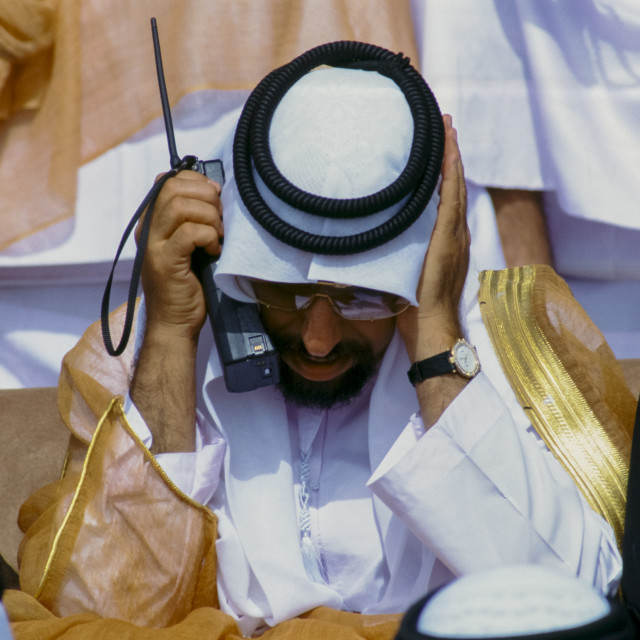 """Arab using two-way radio to communicate during parade of armed forces in Abu..."" stock image"
