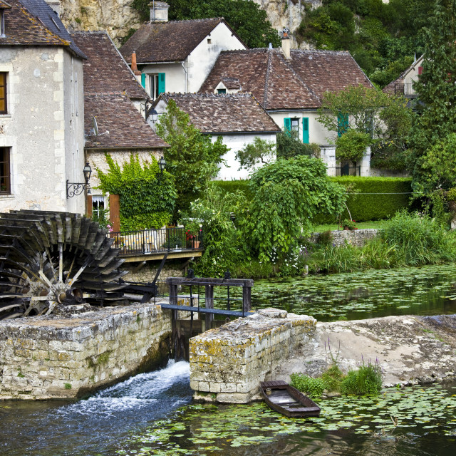 """""""Traditional French houses, water wheel and millrace at Angles Sur L'Anglin..."""" stock image"""