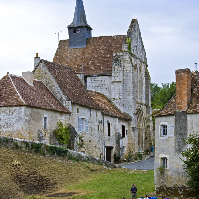 """""""People with kayaks in traditional medieval village of Angles Sur L'Anglin,..."""" stock image"""