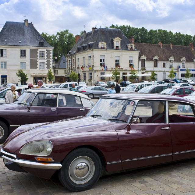 """Traditional Citroen DS saloon cars in Place du Marche town square, Richelieu,..."" stock image"