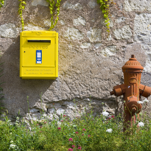"""""""Traditional water hydrant and letter box at Parnay in the Loire Valley, France"""" stock image"""