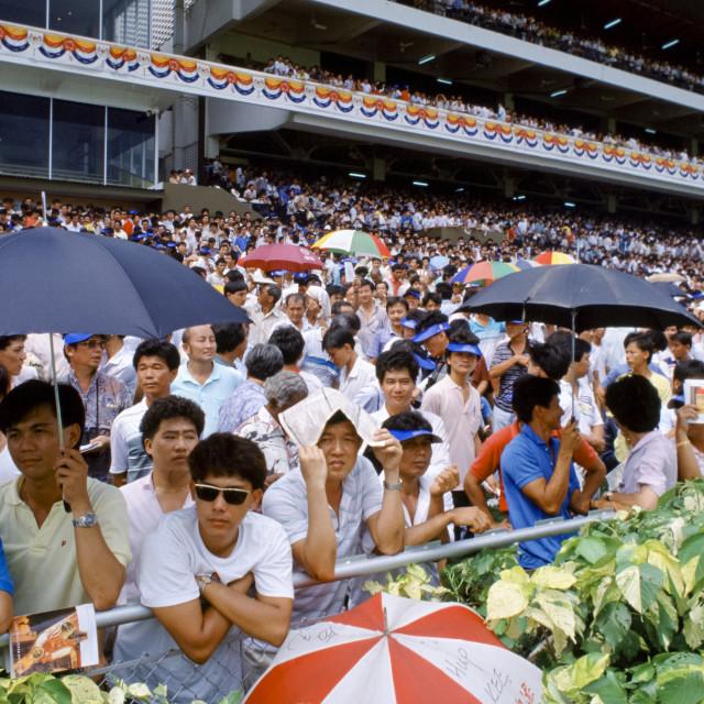 """Racegoers at the racecourse in Hong Kong, China"" stock image"