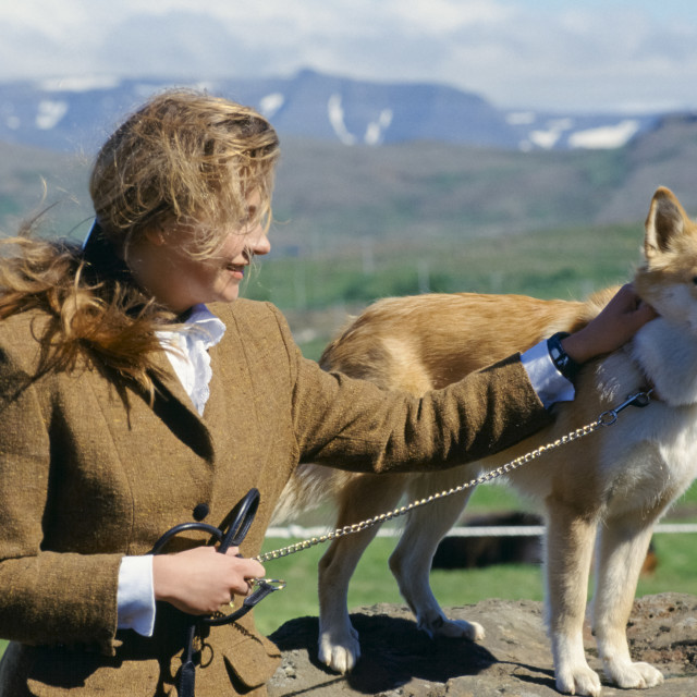 """""""Woman with traditional Icelandic dog at Dalur, Iceland"""" stock image"""