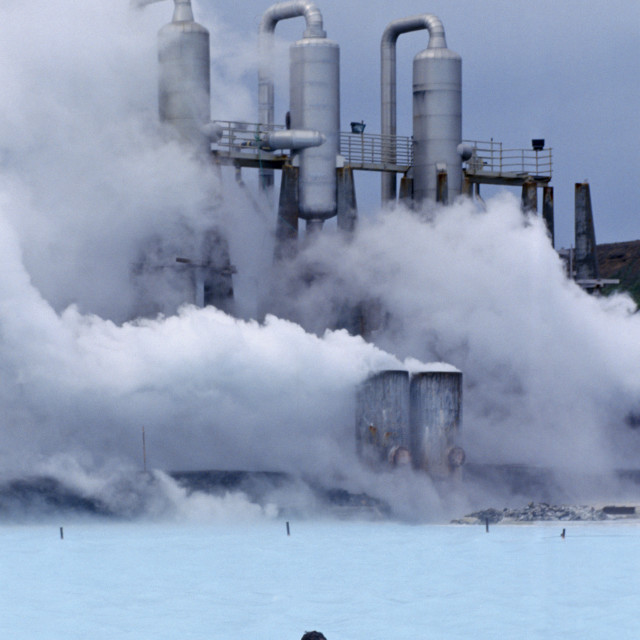 """""""Clouds of steam rise as people swim in the Blue Lagoon thermal pool, Iceland"""" stock image"""