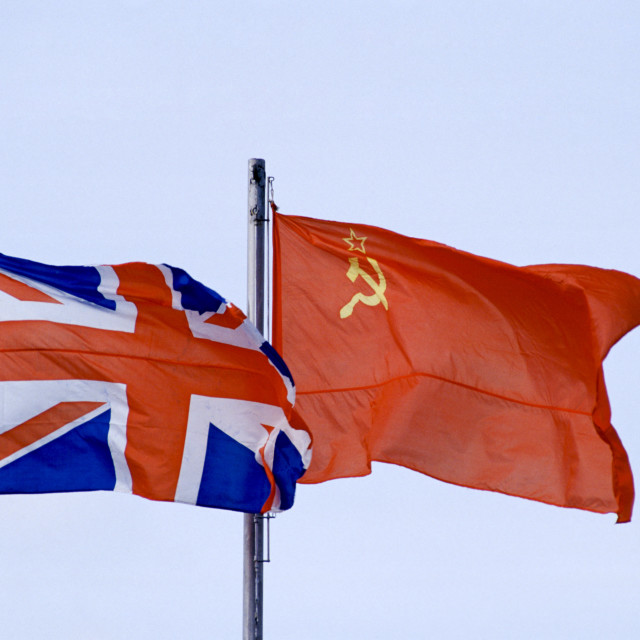 """Hammer and Sickle flag alongside British Union Jack flag flying in Moscow,..."" stock image"