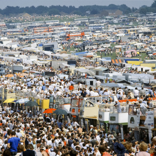 """""""Crowds of spectactors on traditional open-topped buses at Epsom Racecourse..."""" stock image"""