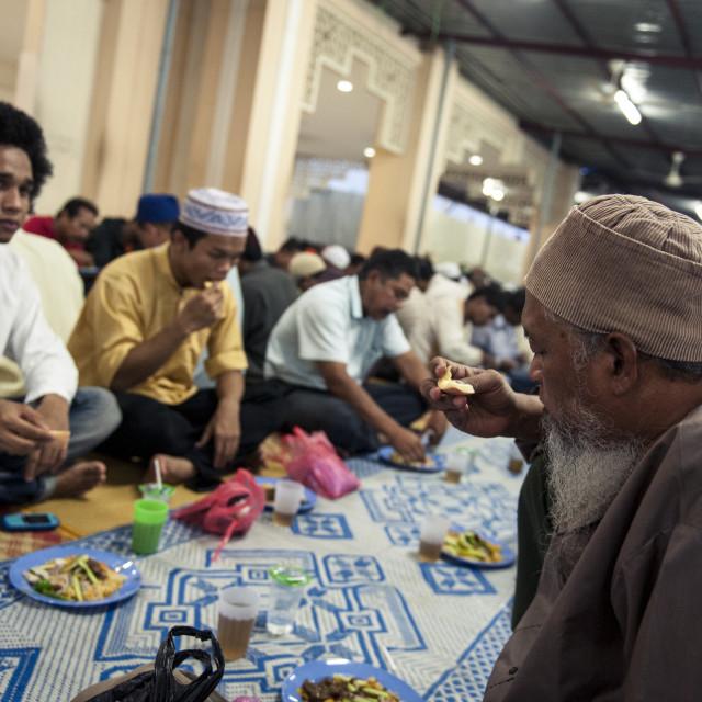 """Muslims break the fast (iftar), Kampung Baru Mosque, Kuala Lumpur, Malaysia,..."" stock image"