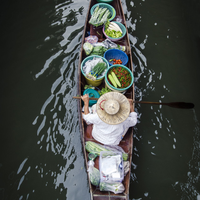 """A vendor paddles their boat, Damnoen Saduak Floating Market, Thailand,..."" stock image"