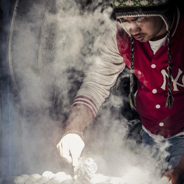 """A man steams momos, Bhaktapur, Nepal, Asia"" stock image"