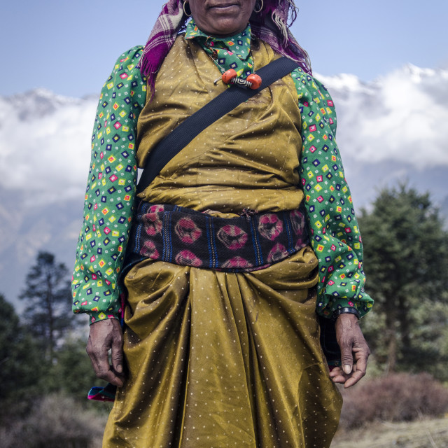 """A woman wearing traditional dress in front of the Himalaya mountains, Mere..."" stock image"