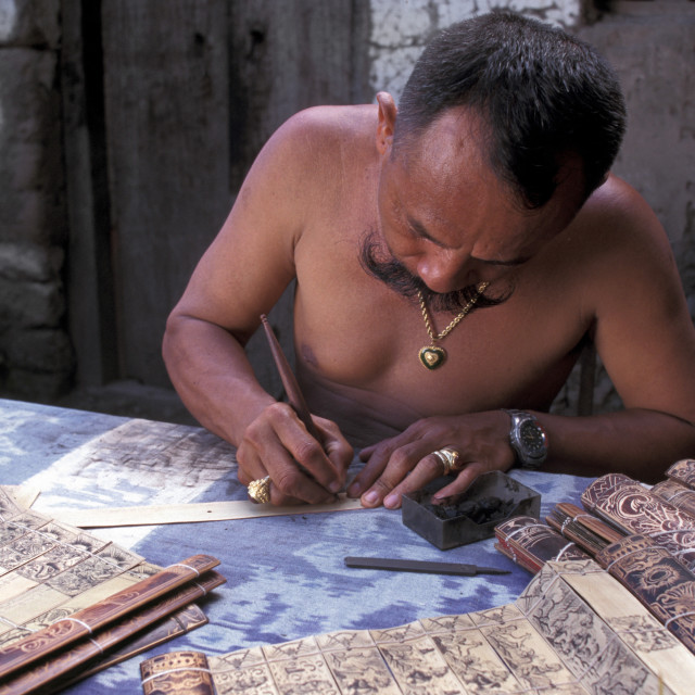 """Man writing lontar manuscripts, Bali, Indonesia, Southeast Asia, Asia"" stock image"