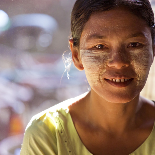 """Local woman with Thanakha traditional face painting, Thiri Mingalar Market,..."" stock image"